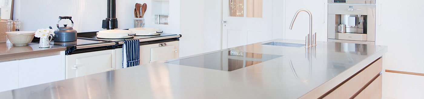 Quartz countertop kitchen remodel with solid-surface edge details